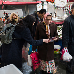 Ozden Oz, a volunteer supporting the No vote, distributes flyers at a street market in Istanbul, Turkey on March 12, 2017.<br /> On April 16, 2017, Turkish citizens will vote on proposed changes on the constitution that could replace the current parliamentary government system with a presidential one.