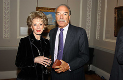 A reception to celebrate the arrival of Deborah Swallow as Director of the Courtauld Institute of Art was held at Somerset House, Strand, London on 9th December 2004.<br />Picture shows:-  BARRY MUNITZ President & Chief Executive officer, The J.Paul Getty Trust and LILY SAFRA.