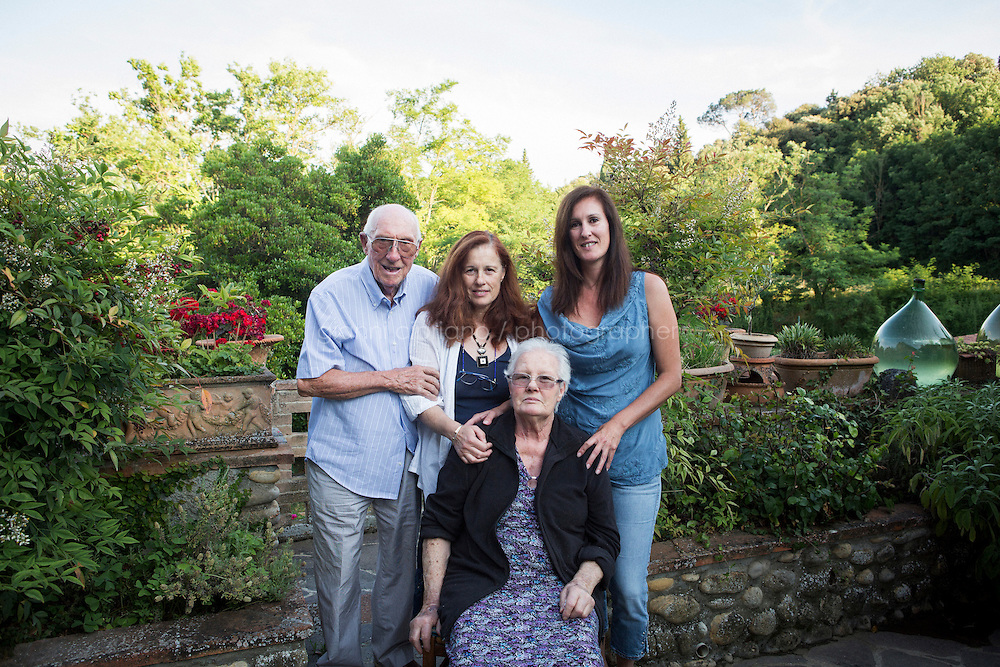 SAN CASCIANO VAL DI PESA, ITALY - 18 JUNE 2014: A family portrait of the Mariasandra Mariani's family with (L-F) Lido Mariani (85, father), Mariasandra Mariani (56),  Fiammetta Tarchi, (82, mother), Mariangela Mariani, (44, sister), in their farm house in San Casciano Val di Pesa, Italy, on June 18th 2014. <br /> <br /> Mariasandra Mariani (56) is an Italian hostage tjat was kidnapped by al-Qaeda in the Islamic Maghreb (AQIM) in Algeria in 2011 and released in Burkina Faso after 14 months in captivity.
