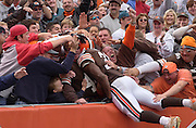 Cleveland Browns running back William Green dives into the Dog Pound after scoring the Brown's first touchdown of the day during the first quarter of Sunday's game against the Philadelphia Eagles. The Eagles beat the Browns 34-31 in overtime.
