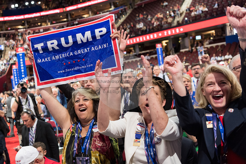 Delegates celebrate the nomination of Donald Trump during the second day of the Republican National Convention July 19, 2016 in Cleveland, Ohio. The delegates formally nominated Donald J. Trump for president after a state by state roll call.