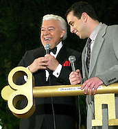 """FILE PHOTO: Entertainer Al Alberts, left, is presented the key to Franklin Mills Mall, by Michael Sheridan, November 16, 2000, in Philadelphia. Alberts was at the mall with his last """"Holiday Showcase"""" of talented young singers and dancers. Alberts passed away November 27, 2009. (Photo by William Thomas Cain/cainimages.com)"""