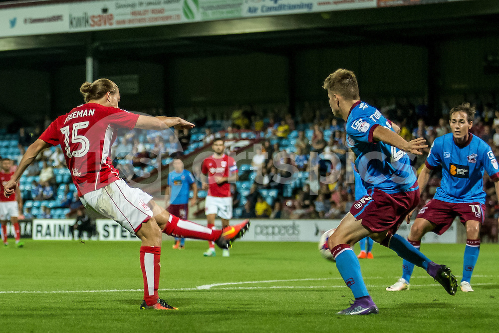 Luke Freeman of Bristol City has a shot on goal during the EFL Cup second round match between Scunthorpe United and Bristol City at Glanford Park, Scunthorpe, England on 23 August 2016. Photo by James Williamson.