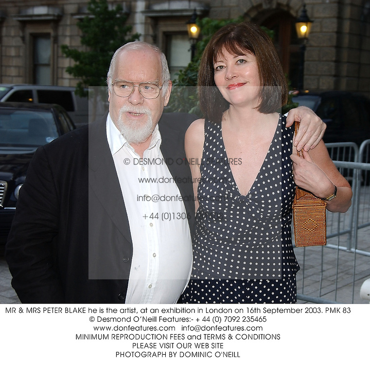 MR & MRS PETER BLAKE he is the artist, at an exhibition in London on 16th September 2003.PMK 83