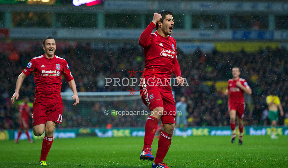 NORWICH, ENGLAND - Saturday, April 28, 2012: Liverpool's Luis Alberto Suarez Diaz celebrates scoring his third goal against Norwich City to complete his hat-trick and seal a 3-0 victory for the Reds during the Premiership match at Carrow Road. (Pic by David Rawcliffe/Propaganda)