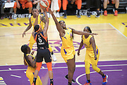 Connecticut Sun guard Jasmine Thomas (5) shoots the ball as Los Angeles Sparks center Kalani Brown (21) defends during a WNBA basketball game, Friday, May 31, 2019, in Los Angeles.The Sparks defeated the Sun 77-70.  (Dylan Stewart/Image of Sport)