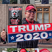 Smiling President Trump supporters demonstrating their first amendement right of free speech.  Make America Great Again&quot; and buttons and signs for Trump.<br />