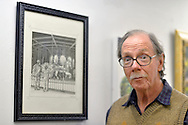 Port Washington, New York, U.S 6th October 2013. ROBERT STUHMER next to his illustration of a carousel at The Artists Reception for Members Showcase of the Art Guild of Port Washington, at The Graphic Eye Gallery.