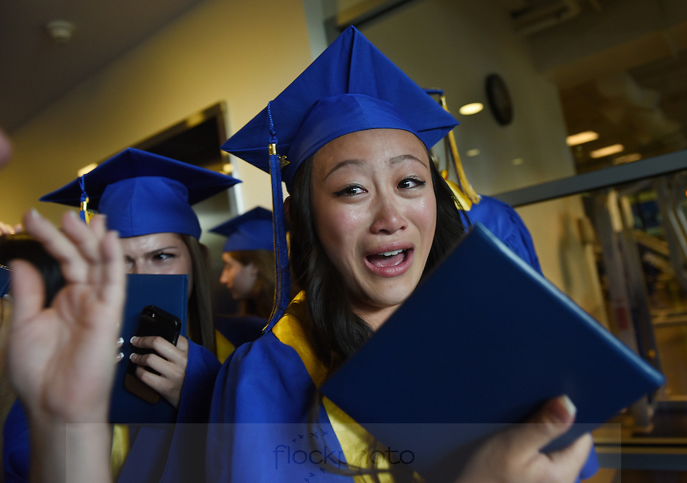Jennifer Ong is overcome with emotion after her graduation from Arlington Catholic High School, Thursday, May 26, 2016.<br /> Wicked Local staff photo / Kate Flock