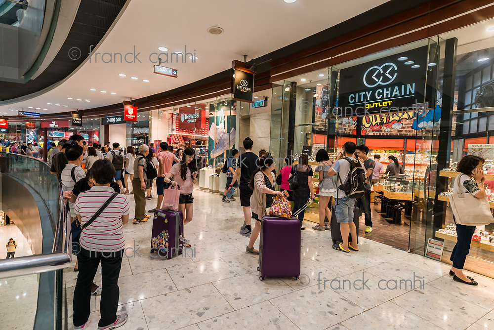 Tung Chung Wan, Hong Kong, China- June 11, 2014: people shopping at the CityGate Outlet shopping mall in Lantau island near the airport
