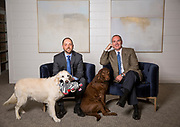Adam L. Hopkins, attorney, and Mark Murphey Henry, registered patent attorney, sit with Duke at Henry Law Firm on Tuesday, May 9, 2017, in Fayetteville, Ark. Photo by Beth Hall