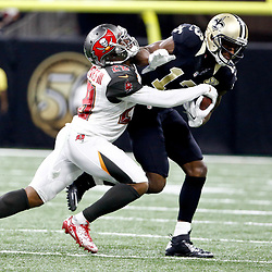 Dec 24, 2016; New Orleans, LA, USA; New Orleans Saints wide receiver Michael Thomas (13) is tackled by Tampa Bay Buccaneers cornerback Vernon Hargreaves (28) during the second quarter of a game at the Mercedes-Benz Superdome. Mandatory Credit: Derick E. Hingle-USA TODAY Sports