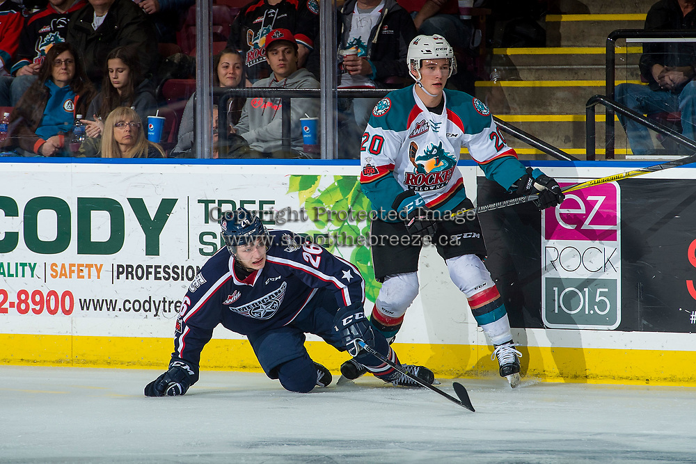KELOWNA, CANADA - JANUARY 3: Conner Bruggen-Cate #20 of the Kelowna Rockets checks Riley Sawchuk #26 of the Tri-City Americans to the ice on January 3, 2017 at Prospera Place in Kelowna, British Columbia, Canada.  (Photo by Marissa Baecker/Shoot the Breeze)  *** Local Caption ***