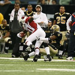 2007 December, 16: New Orleans Saints cornerback Jason David (42) tackles Cardinals receiver Anquan Boldin (81) during a 31-24 win by the New Orleans Saints over the Arizona Cardinals at the Louisiana Superdome in New Orleans, LA.