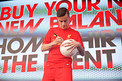 LIVERPOOL, ENGLAND - Monday, May 9, 2016: Liverpool's Philippe Coutinho Correia signs a ball at the launch of the New Balance 2016/17 Liverpool FC kit at a live event in front of supporters at the Royal Liver Building on Liverpool's historic World Heritage waterfront. (Pic by Lexie Lin/Propaganda)