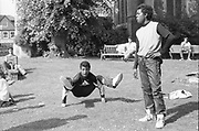 Two kids breakdancing in a church park in High Wycombe, UK, 1980s.