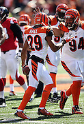 Cincinnati Bengals cornerback Leon Hall (29) celebrates with Cincinnati Bengals defensive tackle Domata Peko (94) after intercepting a third quarter pass during the NFL week 2 regular season football game against the Atlanta Falcons on Sunday, Sept. 14, 2014 in Cincinnati. The Bengals won the game 24-10. ©Paul Anthony Spinelli