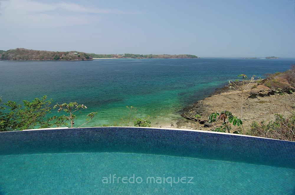 Swimming pool border facing the shore at Contadora island. Las Perlas archipelago, Panama province, Panama, Central America.