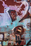 A picture of a graffiti-ed boxcar door.