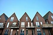 Nederland, Lobith, 1-4-2014Nieuwbouw, woningen in het centrum van het dorp op een balkon staat een parasol.Foto: Flip Franssen/Hollandse Hoogte