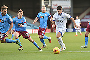 Oldham Athletic midfielder Ryan Flynn (7) up against Scunthorpe United defender Conor Townsend (22) Scunthorpe United defender Charlie Goode (20) and Scunthorpe United midfielder Stephen Dawson (8) during the EFL Sky Bet League 1 match between Scunthorpe United and Oldham Athletic at Glanford Park, Scunthorpe, England on 19 November 2016. Photo by Ian Lyall.