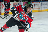 KELOWNA, CANADA - SEPTEMBER 20: Colten Martin #8 of Kelowna Rockets takes a shot during warm up against the Kamloops Blazers on September 20, 2014 at Prospera Place in Kelowna, British Columbia, Canada.   (Photo by Marissa Baecker/Shoot the Breeze)  *** Local Caption *** Colten Martin;