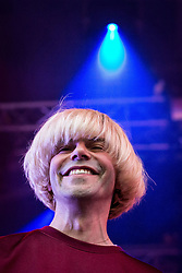 """© Licensed to London News Pictures . 04/07/2015 . Manchester , UK . The Charlatans perform at the Castlefield Bowl as part of the """" Summer in the City """" festival in Manchester. Photo credit : Joel Goodman/LNP"""