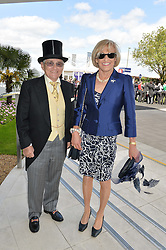 WILLIE CARSON and his wife ELAINE at the Investec Derby 2015 at Epsom Racecourse, Epsom, Surrey on 6th June 2015.