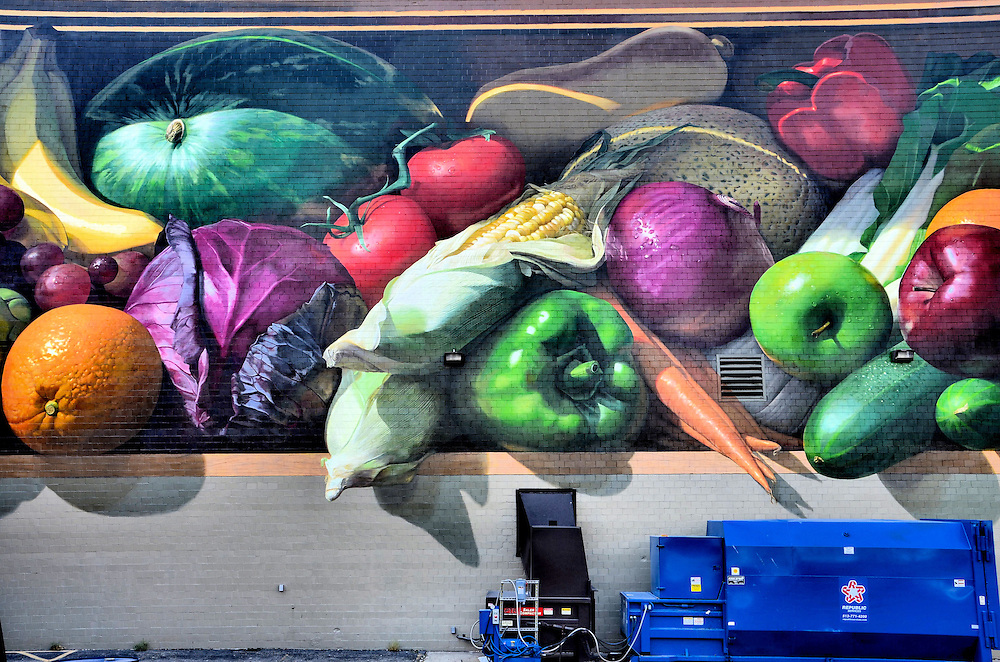 Fresh Harvest Mural by Jonathan Queen from ArtWorks in Cincinnati, Ohio<br /> On the side of the Kroger grocery headquarters in downtown Cincinnati, Ohio, is this delicious looking mural of vegetables and fruits called, &ldquo;Fresh Harvest.&rdquo; Jonathan Queen was the lead artist. It is another inspirational wall mural by ArtWorks. This organization provides apprenticeships to a wide ethnic mix of youth from 67 schools and 75 neighborhoods.