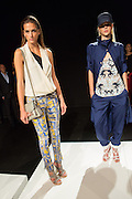 Print pants in muted yellow and blue, a wrap sleeveless top in off-white with asymmetrical black lining. On the right, A finely beaded top under a loose blue jacket with matching trousers. By Monika Chiang at Spring 2013 Fashion Week in New York.
