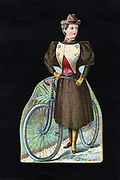 Cycling: American display card showing ladies' cycling dress c1890. Skirt worn over knickerbockers. Lithograph.