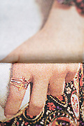 extreme hand close up crop from a newspaper style print or magazine with halftone print dots