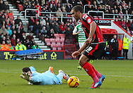Picture by Tom Smith/Focus Images Ltd 07545141164<br /> 26/12/2013<br /> Lewis Grabban (right) of Bournemouth rounds Marek Štēch (left) of Yeovil Town during the Sky Bet Championship match at the Goldsands Stadium, Bournemouth.
