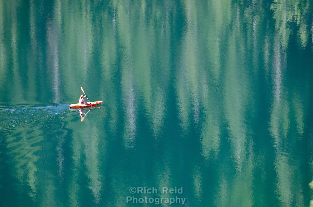 A lone kayaker on Lower Sardine Lake in Tahoe National Forest, California.