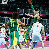 06 August 2012: Brazil Tiago Splitter goes for the skyhook past Spain Pau Gasol during 88-82 Team Brazil victory over Team Spain, during the men's basketball preliminary, at the Basketball Arena, in London, Great Britain.