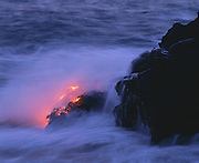 0801-1000J ~ Copyright:  George H. H. Huey ~ Molten lava flowing into the ocean at Kupapa'au, at dusk.  Hawaii Volcanoes National Park.  The Big Island, Hawaii.