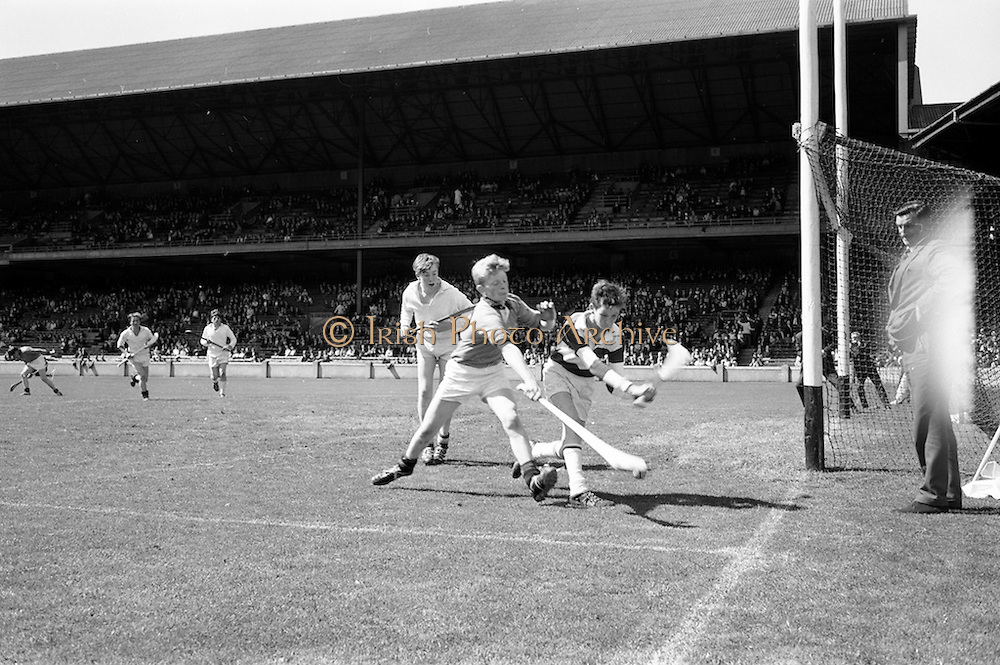 18/08/1968<br /> 08/18/1968<br /> 18 August 1968<br /> Under 16 Hurling Final: Down v Kildare at Croke Park, Dublin.<br /> Down player, number 12, as he tries to get a shot at a goal but he was thwarted by the Kildare golie.