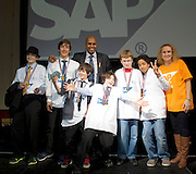 16/02/2014  St Kilian's1  Roebuck Road Clonskeagh(pictured with Paul Sleem MC and Yvonne McArdle SAP) at the 8th annual SAP FIRST LEGO League challenge in Galway!&nbsp; The global theme for this year&rsquo;s competition; &ldquo;Nature&rsquo;s Fury&rdquo; was very apt for Irish Students and many of the projects were inspired by recent disastrous impact of the weather in local communities.<br /> &nbsp;<br /> The winners, SGC Robotics from St. Gerald&rsquo;s Secondary School in Castlebar, will now go on to represent Ireland at the European finals of the competition in Spain in May. They will follow in the footsteps of other very successful Irish teams who have in the past been recognised and awarded prizes on the international stage.<br /> Bernard Kirk, Director, The Galway Education Centre who brought the FIRST LEGO League to Ireland 8 years ago and have hosted it every year since, &ldquo; We see these students not just as LEGO and robotics experts, they are architects, engineers and genuine enthusiasts. Irish students have become recognised all over the world through their successes in this competition at global level and we are extremely proud of them and their teachers&rdquo;. Photo:Andrew Downes