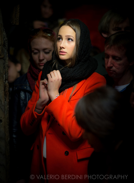 A girl prays among believers in the Church of the Nativity in Bethlehem