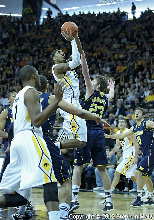 January 14, 2011: Iowa Hawkeyes guard/forward Roy Devyn Marble (4) puts up a shot past Michigan Wolverines forward Evan Smotrycz (23) during the NCAA basketball game between the Michigan Wolverines and the Iowa Hawkeyes at Carver-Hawkeye Arena in Iowa City, Iowa on Saturday, January 14, 2011. Iowa defeated Michigan 75-59.