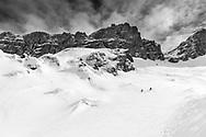 Two ski tourers ar skiing down from mount Glatten, Muotathal, Schwyz, Switzelrand