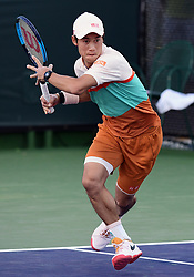 March 8, 2019 - Indian Wells, CA, U.S. - INDIAN WELLS, CA - MARCH 08: Kei Nishikori (JPN) chargers the net in the first set of a doubles match during the BNP Paribas Open played at the Indian Wells Tennis Garden in Indian Wells, CA. (Photo by John Cordes/Icon Sportswire) (Credit Image: © John Cordes/Icon SMI via ZUMA Press)