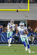 Jan 12, 2019; Los Angeles, CA, USA;  Dallas Cowboys quarterback Dak Prescott (4) attempts to throw a pass to wide receiver Amari Cooper (19) against the Los Angeles Rams during an NFL divisional playoff game at the Los Angeles Coliseum. The Rams beat the Cowboys 30-22. (Kim Hukari/Image of Sport)