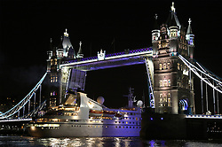 """© Licensed to London News Pictures. 17/09/2013. The last cruise ship to visit London in 2013 has departed the capital. """"Seabourn Pride"""" transited through iconic Tower Bridge at 11pm on Monday night, marking the end of London's cruise ship season for 2013.  Passengers who boarded the 133 metre long vessel in London are beginning a 14 day cruise to Portugal. Six cruise ships have moored in the Upper Pool by HMS Belfast this year. Other ships visiting the Thames have used terminals at Greenwich and Tilbury, Essex. Credit : Rob Powell/LNP"""