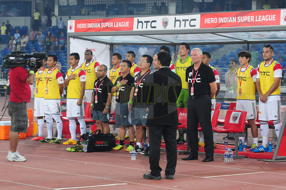 Teams line up for the national anthem during match 16 of the Hero Indian Super League between The Delhi Dynamos FC and NorthEast United FC held at the Jawaharlal Nehru Stadium, Delhi, India on the 29th October 2014.<br /> <br /> Photo by:  Arjun Panwar/ ISL/ SPORTZPICS