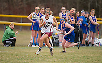 Concord's Lexi Erickson goes for a loose ball during NHIAA Division I Lacrosse with Londonderry Tuesday afternoon.  (Karen Bobotas/for the Concord Monitor)