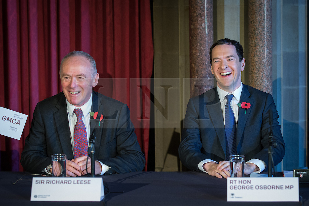 © Licensed to London News Pictures . 03/11/2014 . Manchester , UK . Sir Richard Leese and The Chancellor of the Exchequer , George Osborne MP at Manchester Town Hall signing a deal to devolve power to Greater Manchester , including giving the city a Mayor and greater control over its finances . Photo credit : Joel Goodman/LNP