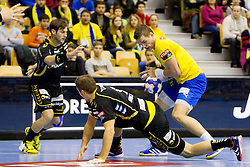 Nikola Manojlovic #9 of Rhein-Neckar Lowen vs Vid Poteko #15 of RK Celje Pivovarna Lasko during handball match between RK Celje Pivovarna Lasko (SLO) vs Rhein-Neckar Lowen (GER) in 3rd Round of Group A of EHF Champions League 2013/14 on October 12, 2013 in Arena Zlatorog, Celje, Slovenia. (Photo By Urban Urbanc / Sportida)