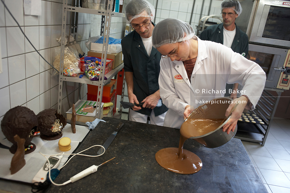 Pouring experimental biscuit chocolate in the United Biscuits-owned Delacre production factory in Lambermont, Belgium.
