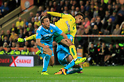 Burton Albion defender Stephen Warnock (3), Norwich City midfielder Josh Murphy (11) and Burton Albion defender John Brayford (2) get in a tangle looking for the ball during the EFL Sky Bet Championship match between Norwich City and Burton Albion at Carrow Road, Norwich, England on 12 September 2017. Photo by Richard Holmes.